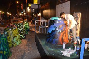 Solomon spray painting compost bins for Jerusalem parks