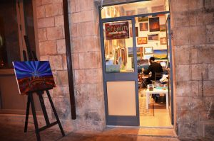 Machane Yehuda artist at work painting