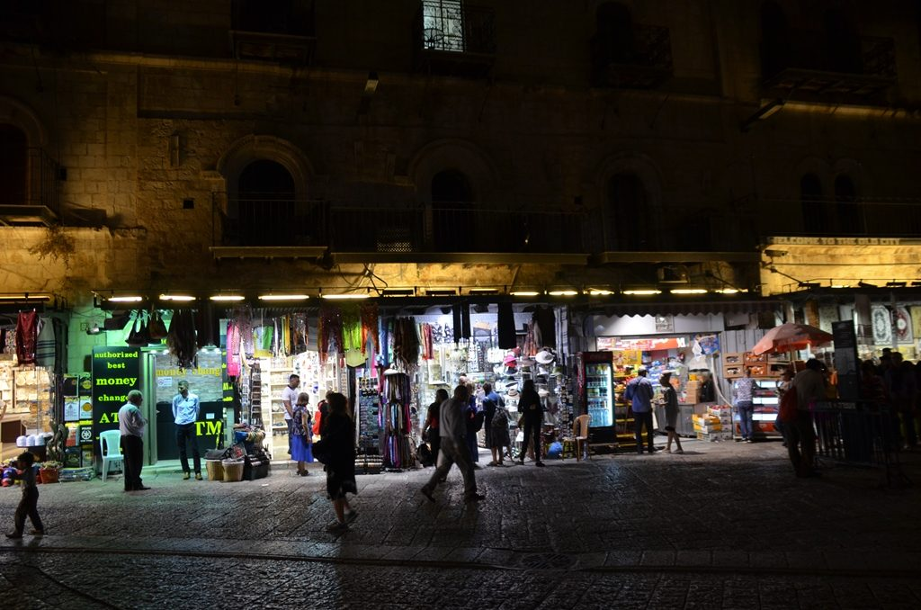 Inside Jaffa Gate at night shoppers.