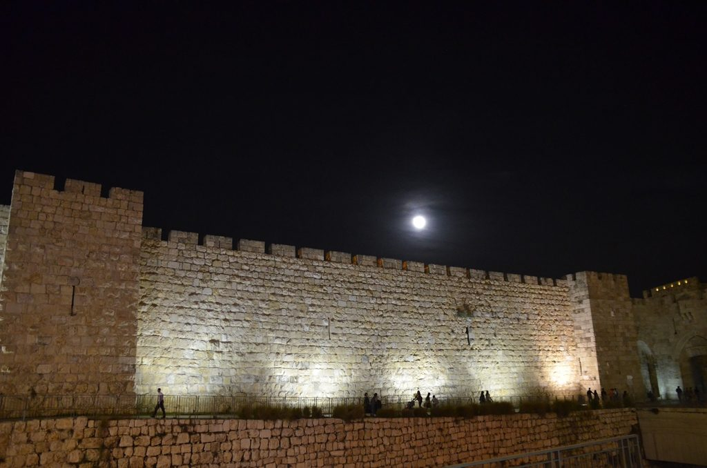 Walls of Old City lit at night from Jaffa Gate