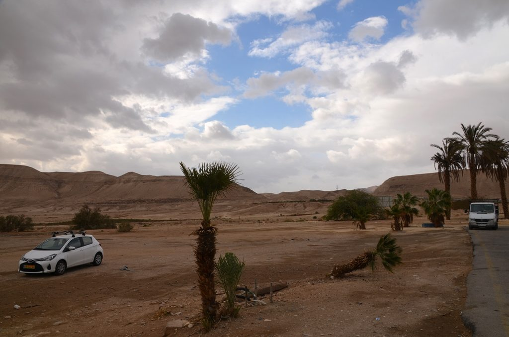 Desert scene with cloudy sky