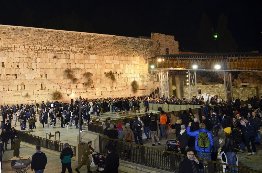 Crowd near Western Wall for chanukah menorah lighting and blessings.