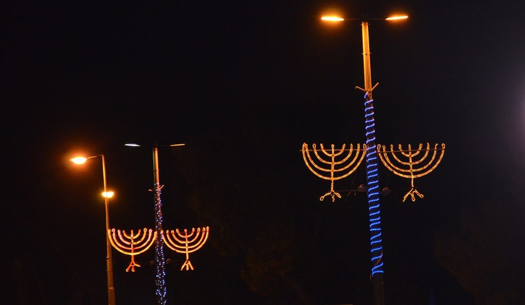Jerusalem street lights with hanukiot lit up for chanuka