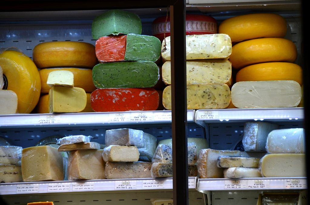 Multi colored cheeses in machane yehuda market