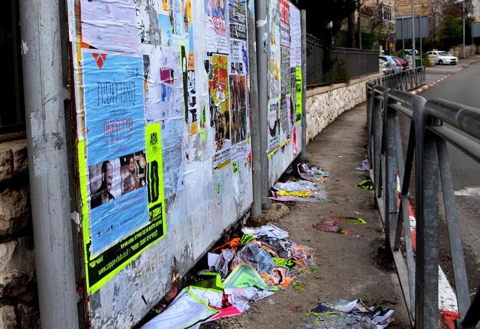 Washed away ads from heavy rain in Jerusalem, Israel
