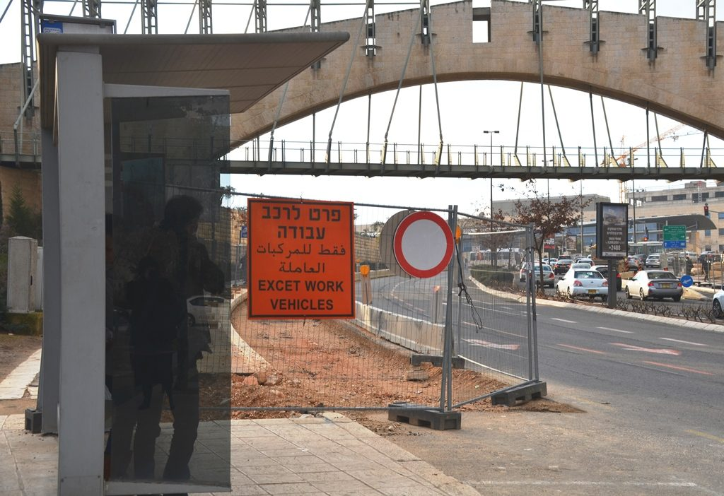 Warning sign with incorrect English written on sign near construction