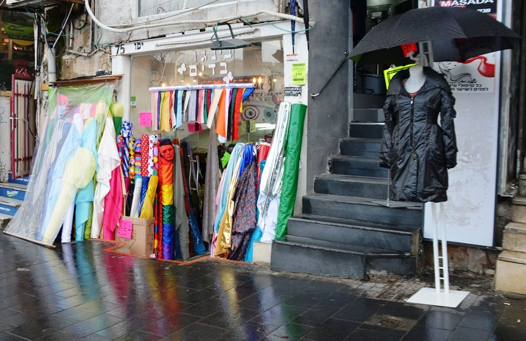 Rainy day with fabric out on street for Purim costumes