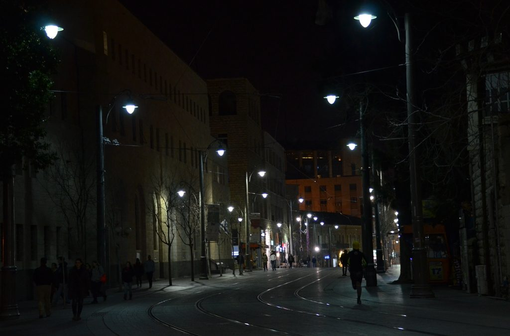 runner on Jaffa Road at night