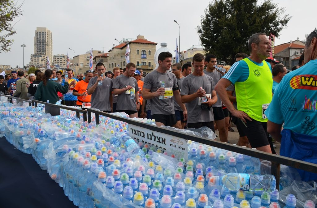 Bottles of water lined up for runners at Jerusalem marathon