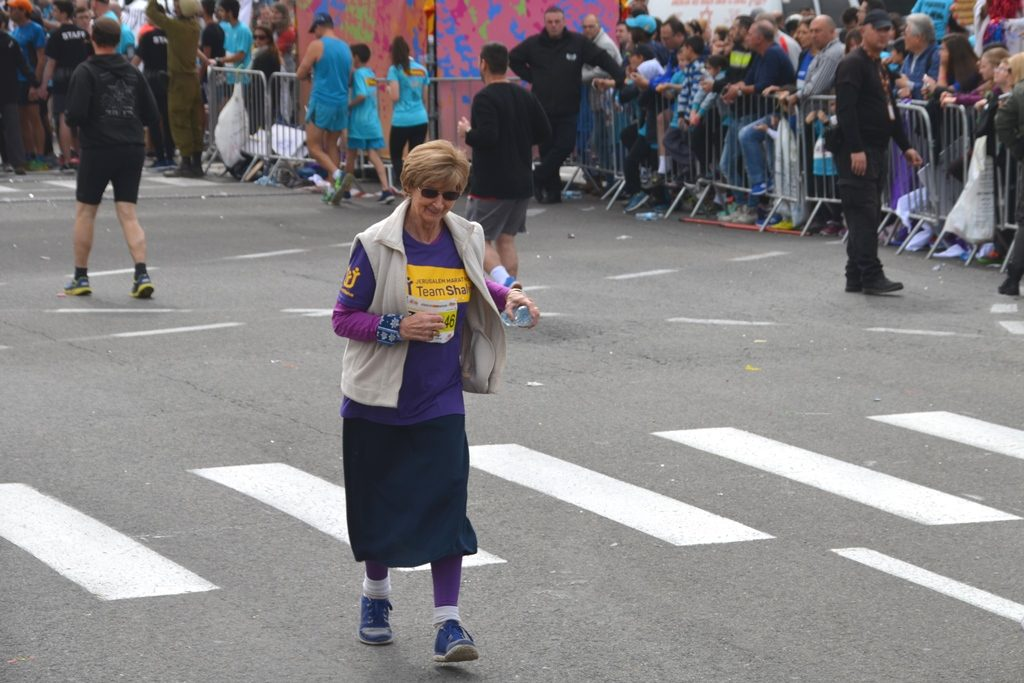Woman who walks for Shalva in Jerusalem Marathon