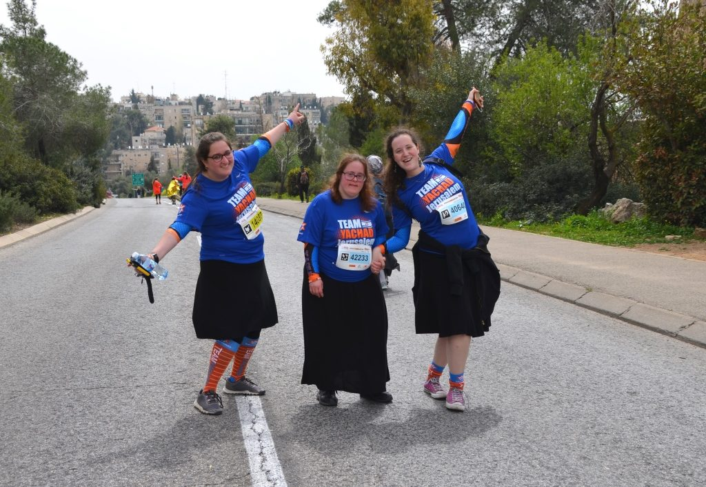 Three girls completing 10 K walk in Jerusalem marathon