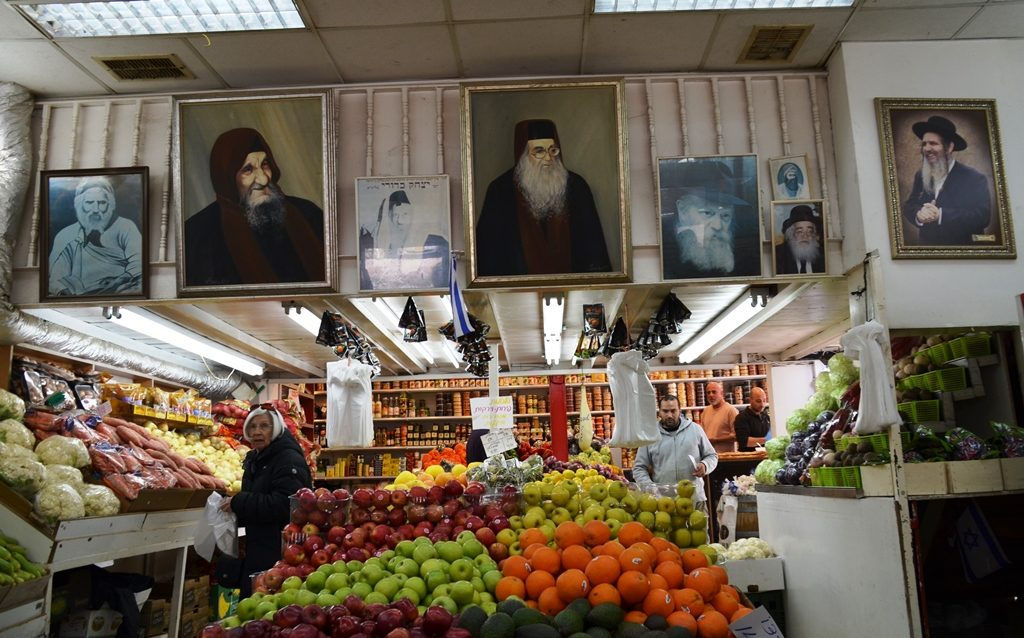 Jerusalem Israel produce store with photos of Rabbis on wall