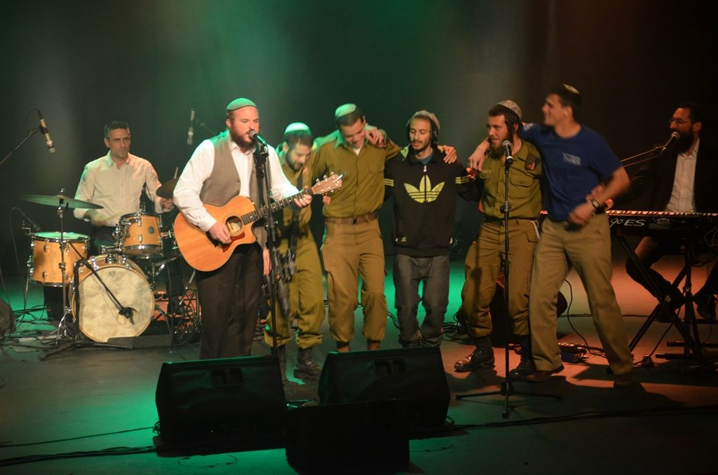 Lone IDF soldiers on stage with Shlomo Katz at benefite conert.