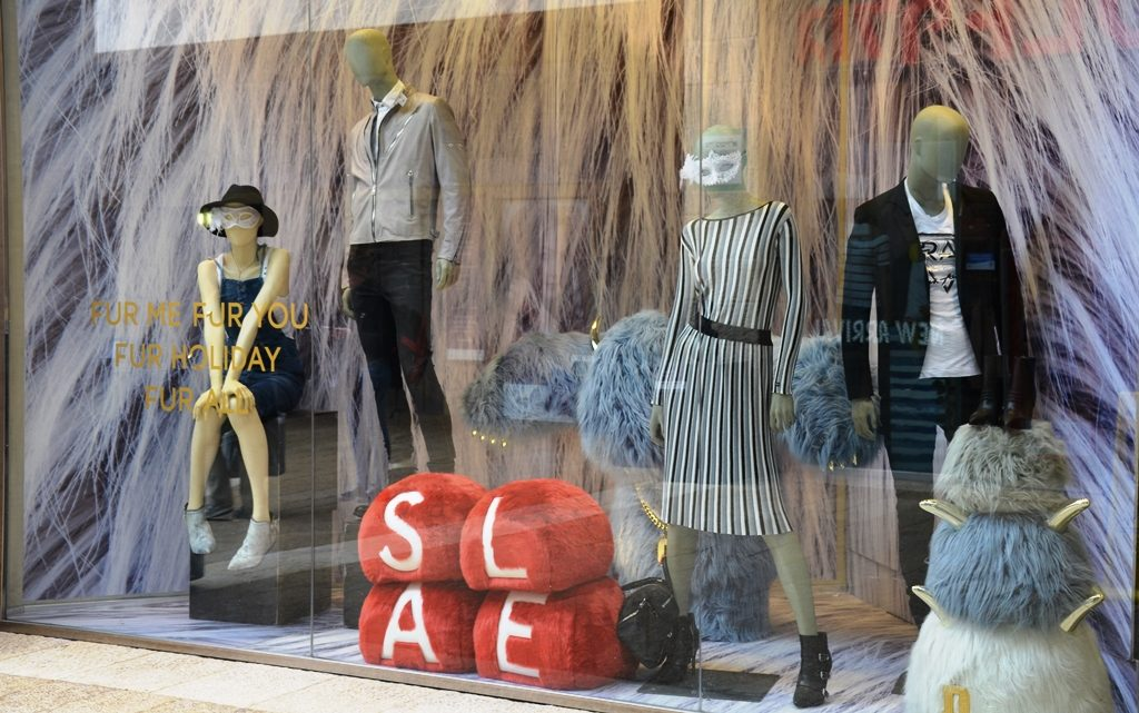 Store mannequins with masks on for Purim