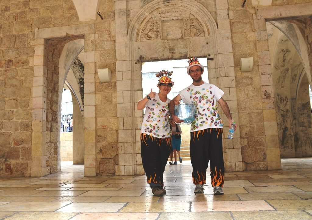 Couple dressed in costumes for Purim Mamilla Mall Jerusalem Israel