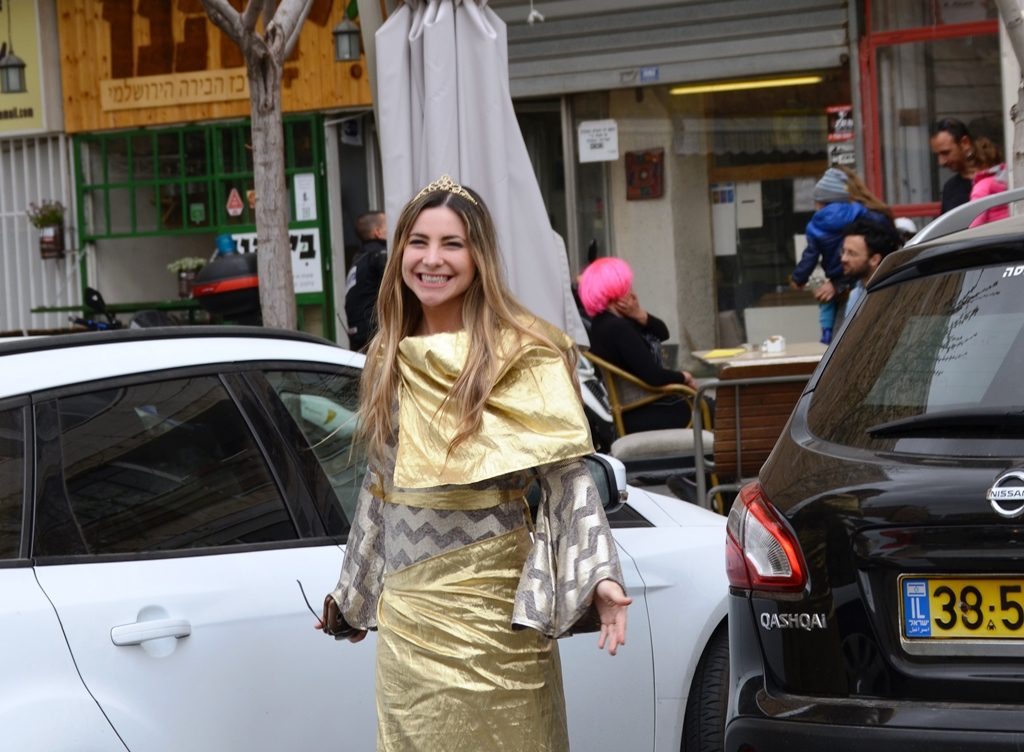 Purim costume of gold on woman in Jerusalem for Purim