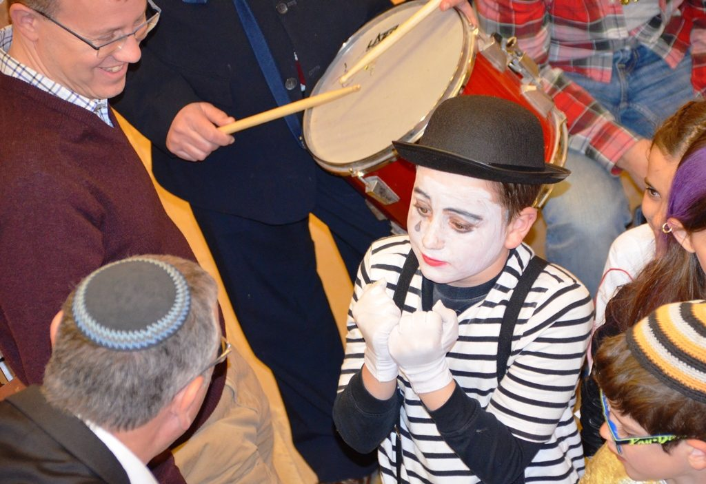 Child dressed as mime for Purim in Jerusalem Israel