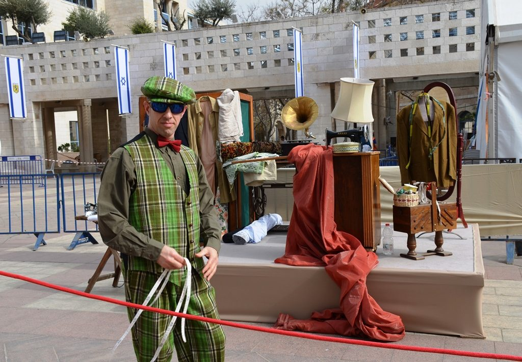 Actor dressed as tailor in Jerusalem Kikar Safra for festival