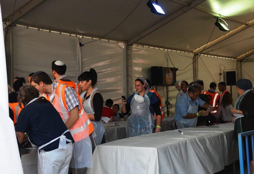 Baking matza at Kikar Safra Matzah Festival