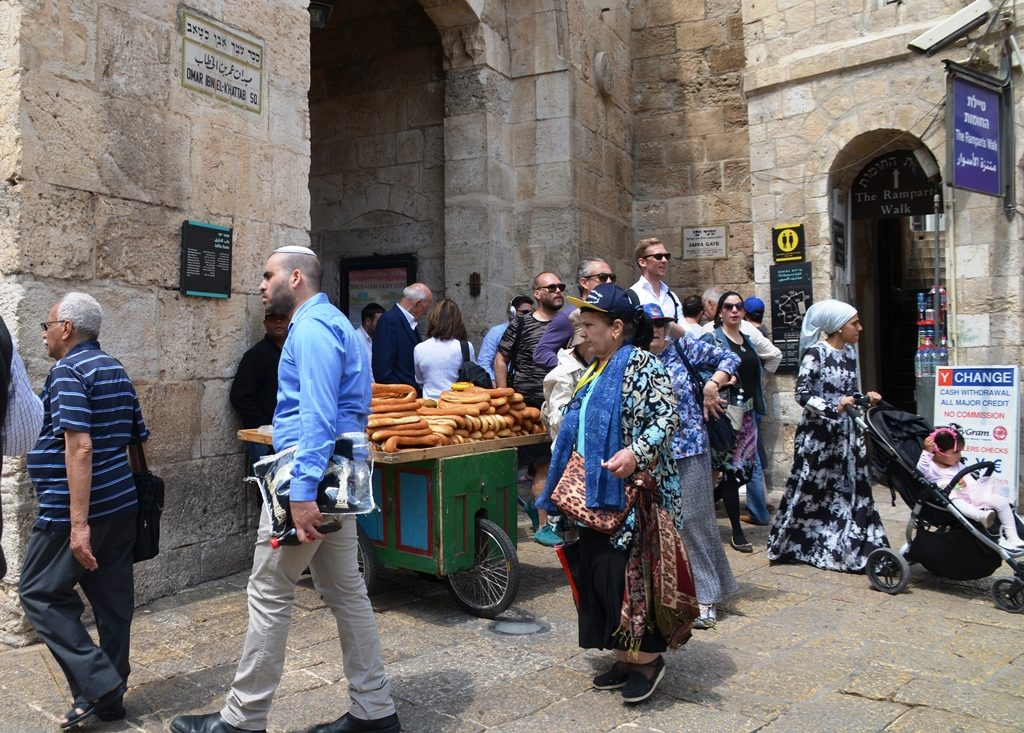 Jaffa Gate on Pesach with man selling bread