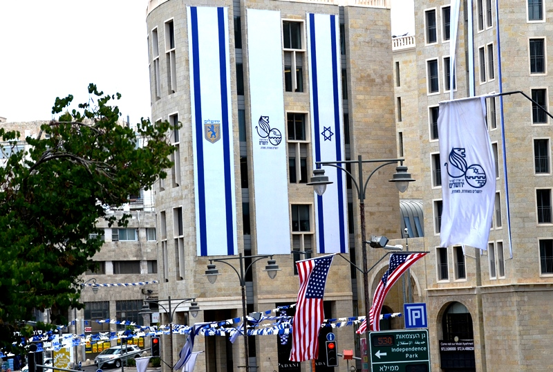 Jerusalem and Israel large flags on buildings