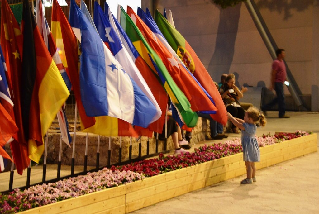 Little girl looks at flags outside international book fair in Jerusalem Israel