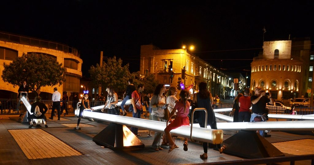 Seesaws of various sizes with light and sound called Impulse at Zahal Square for Jerusalem Light Festival 2017