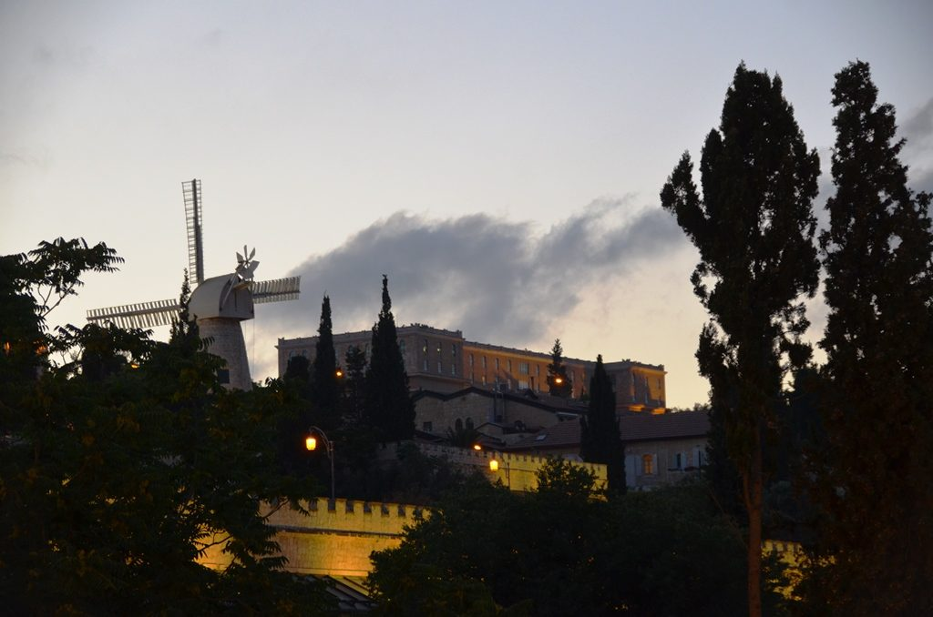 Jerusalem Israel summer clouds. over King David Hotel and Montefiore Windmill