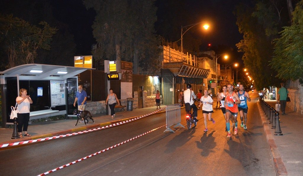 runners in Jerusalem Maccabiah Night Run Emek Refaim Street