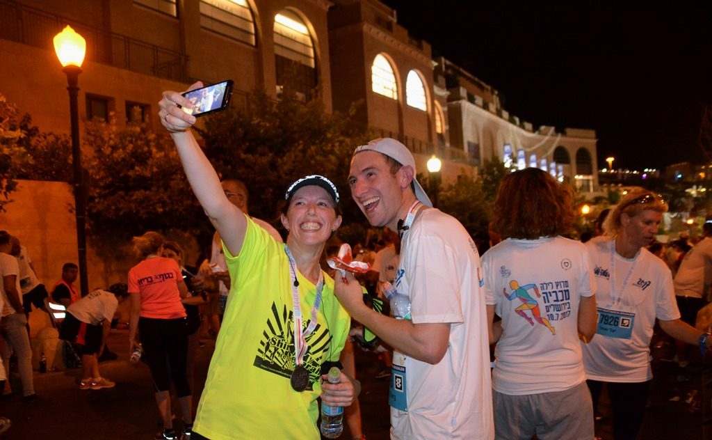 People taking a selfie photo at end of Jerusalem Maccabiah Night Run