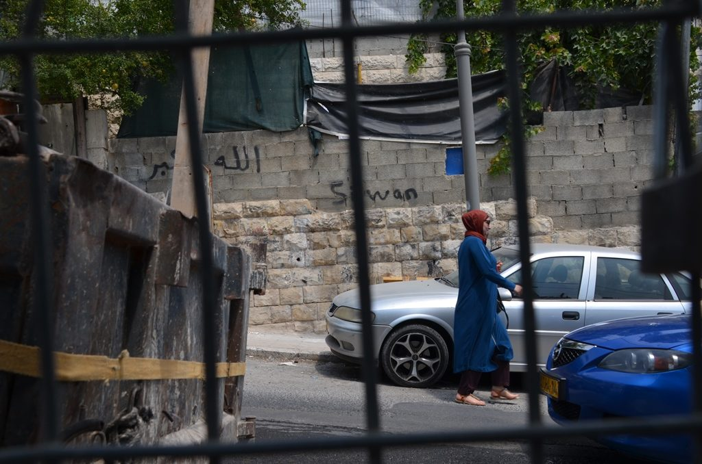 Arab woman walking in Silwan near Ir David