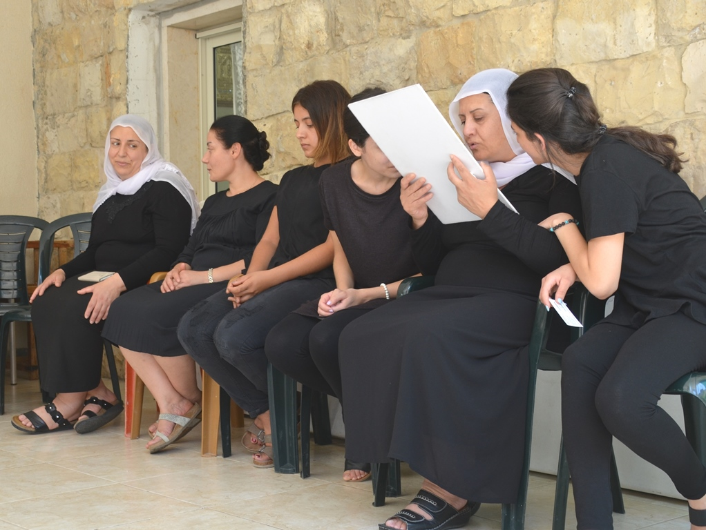 Druze female mourners dressed in black with white scarves