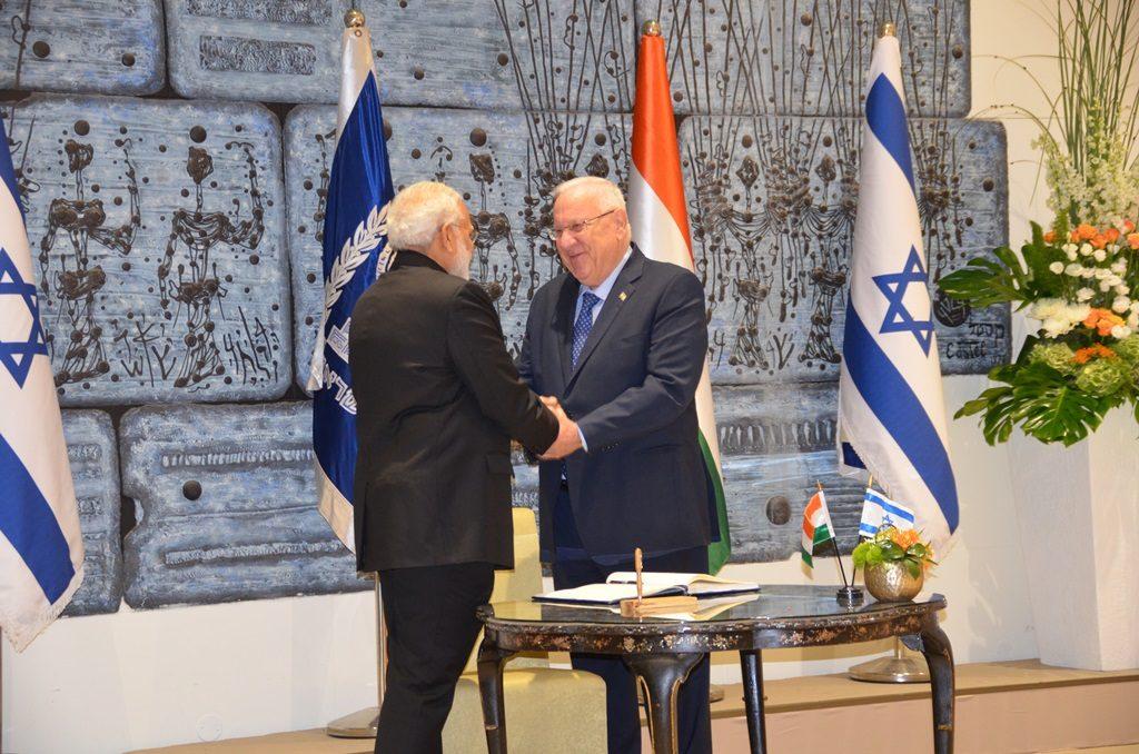 President Rivlin and PM Modi shake hands after signing guest book in Jerusalem Israel