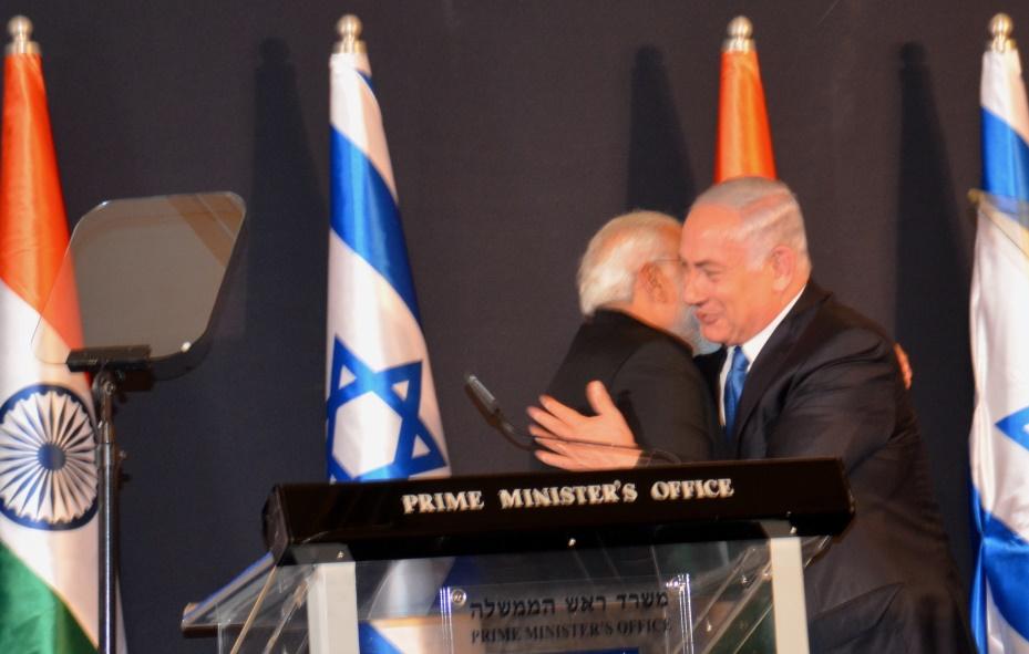Prime Minister Benjamin Netanyahu and Prime Minister Modi of India hug in Jerusalem after signing of agreements