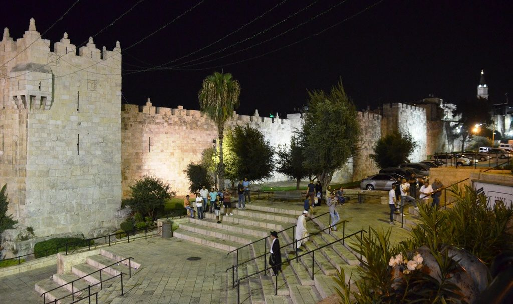 Two men walking on step of Damascus Gate