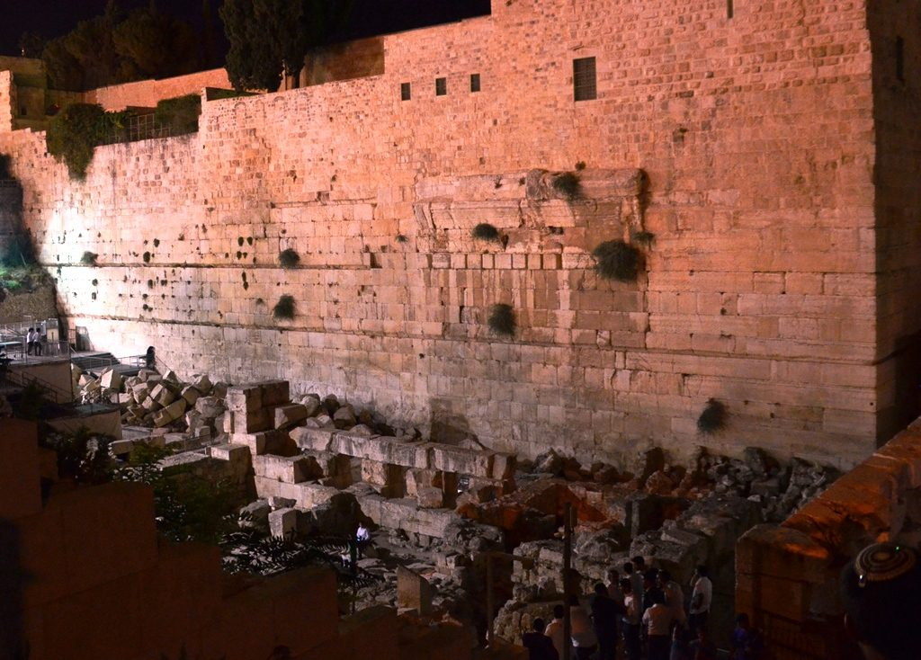 Western Wall has large stones from destruction at base of wall