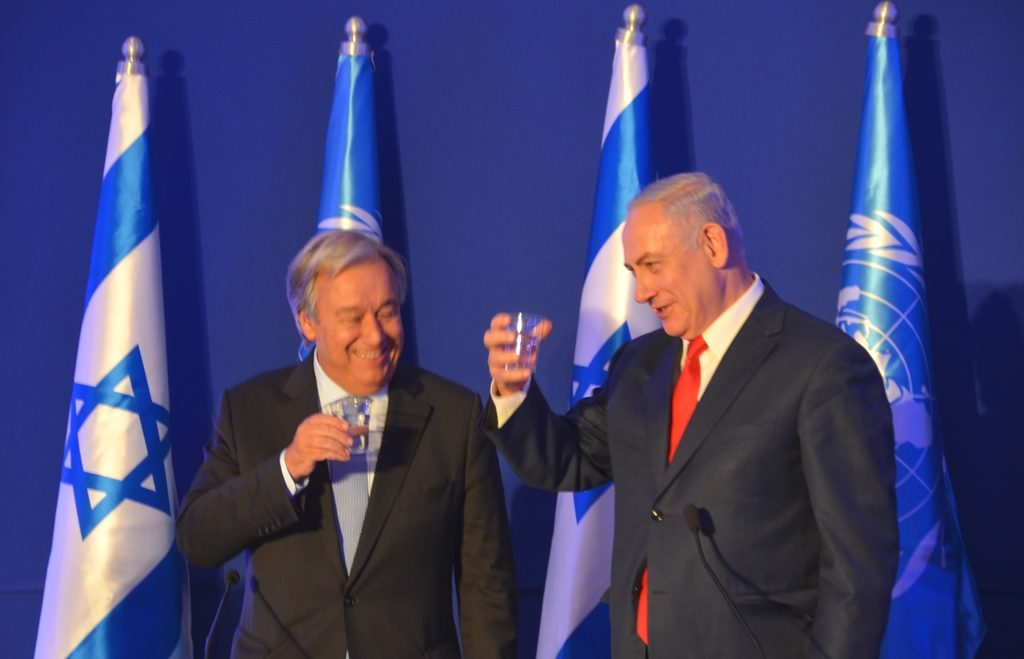 UN Sec-Gen Guterres and PM Netanyahu raise glasses of water to drink, water made from nothing, but taken from air
