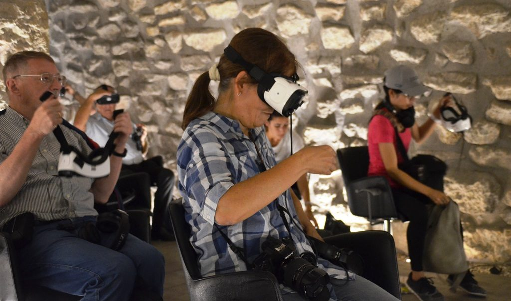 Western Wall tunnels virtual tour people in room with goggles on to see show