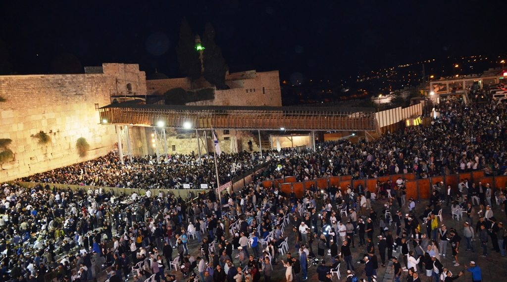 Western Wall Plaza full of people for sehlhos after midnight