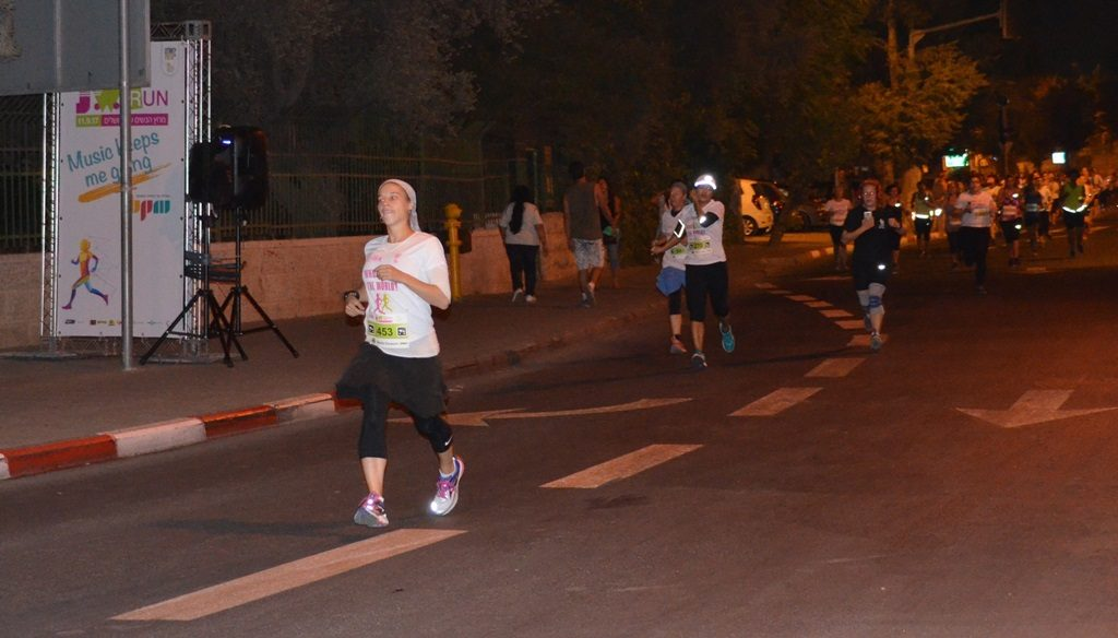 Running in night in Jerusalem Israel Women's Night Run