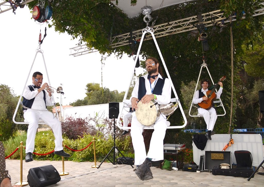 Musicians sitting above ground to perform at Israeli President's House