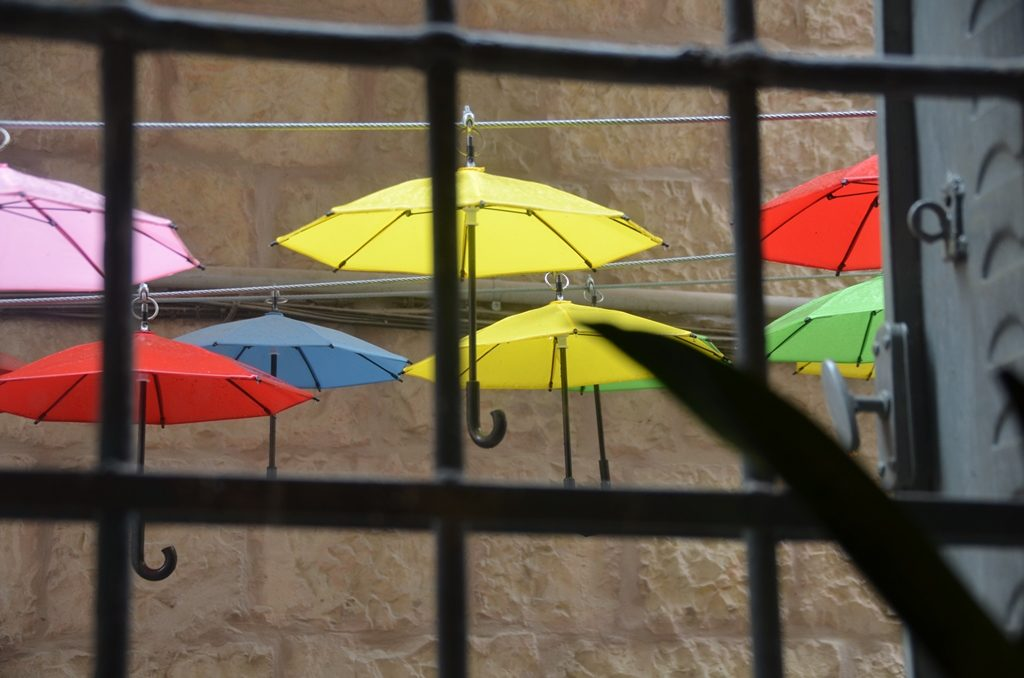 Decorative umbrellas on rainy day