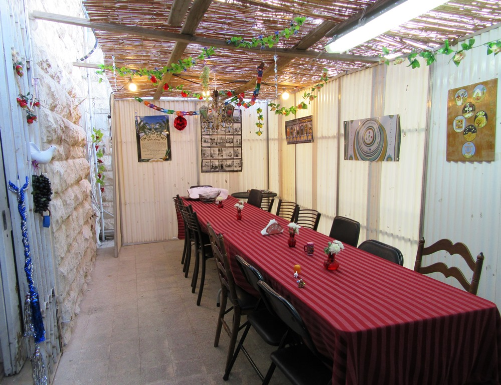 Table ready in sukkah for meal