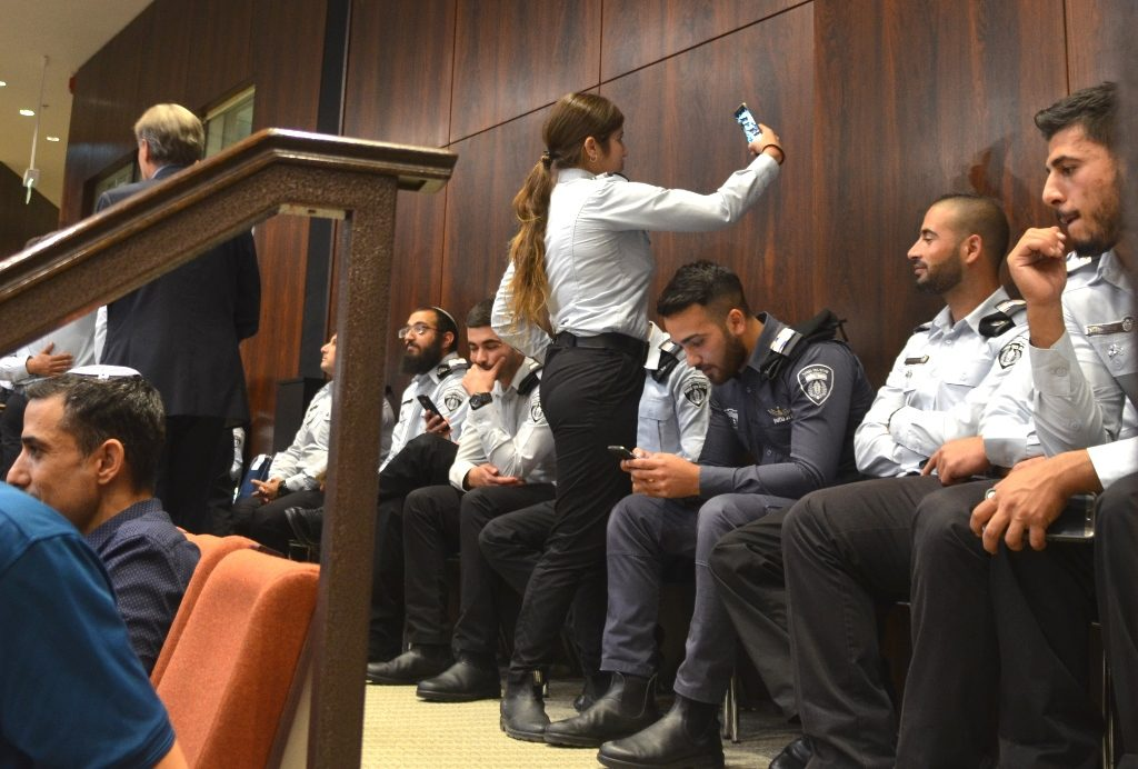 Female security woman taking selfie at Knesset opening