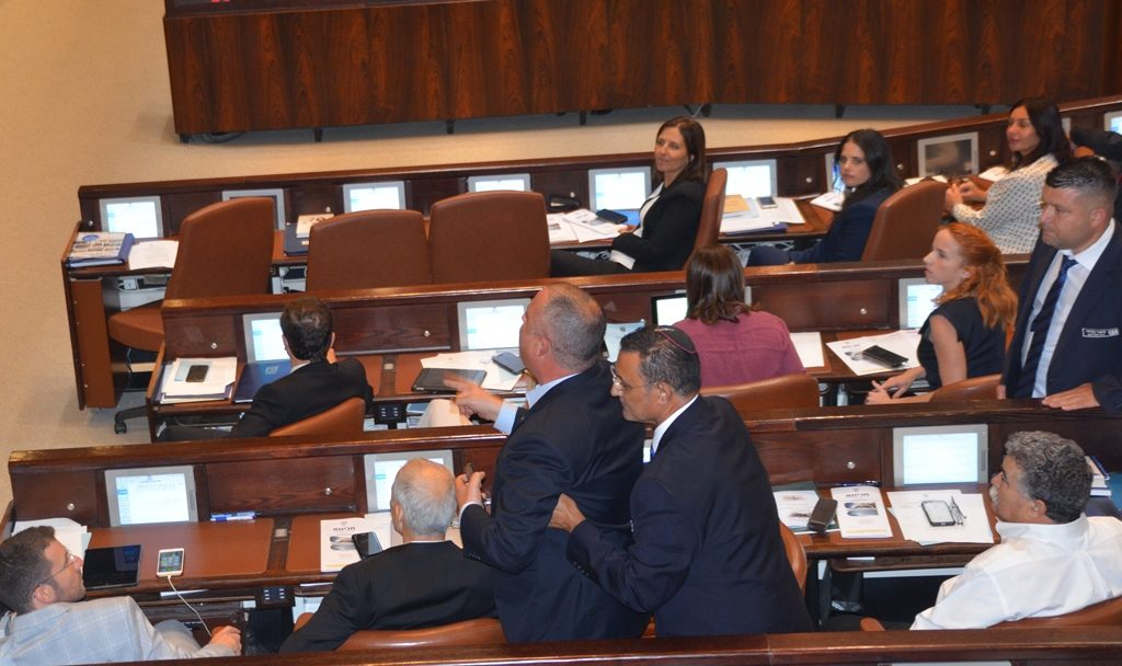 Not being quiet during speech, MK is escorted out of Knesset by security