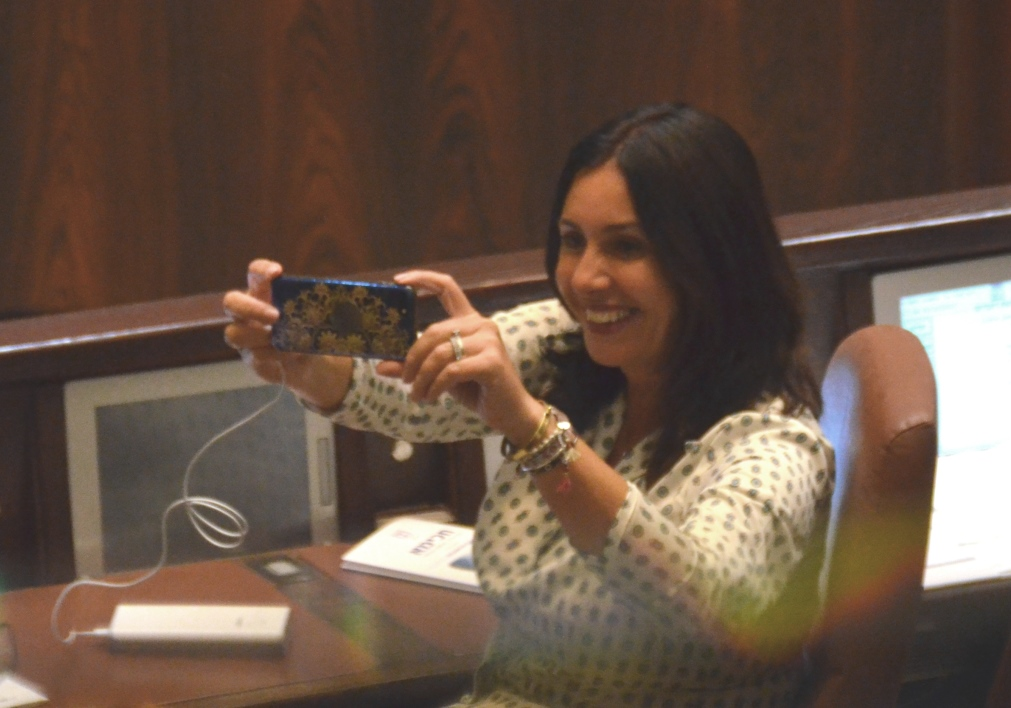 Miri Regev taking photos on cell phone in Knesset opening session