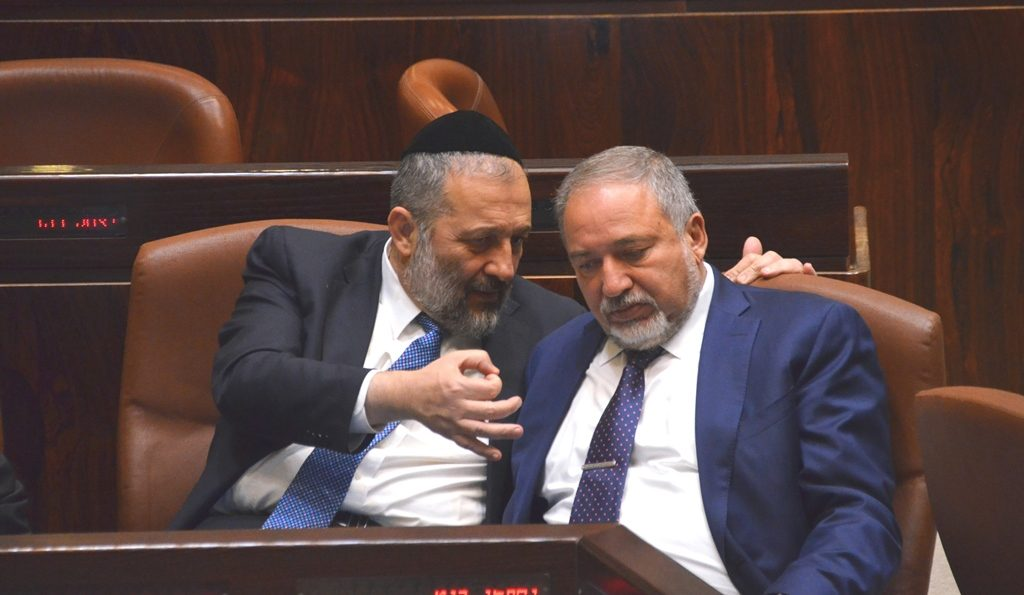 Deri and Leiberman talk during session of Knesset