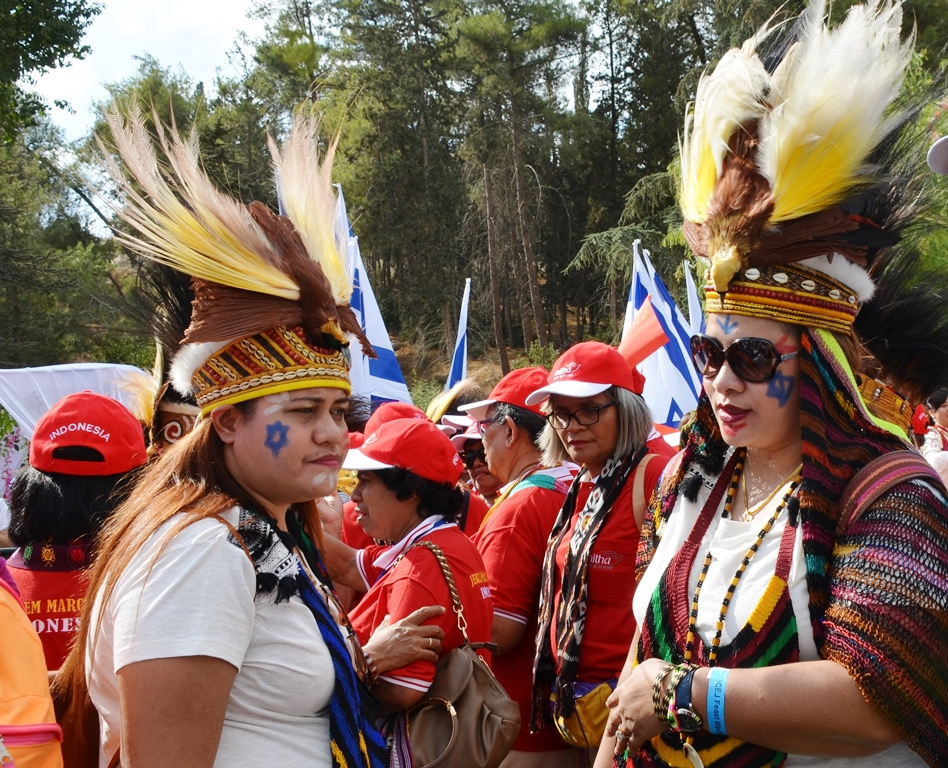 Blue stars on their cheeks and feather head dress for Jerusalem March
