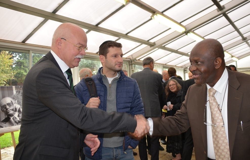 German Ambassador shaking hands with African representative