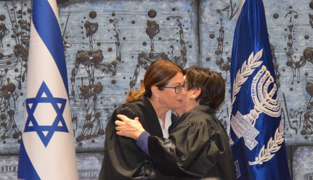 Two female Israeli Supreme Court Presidents kiss at Beit Hanasi ceremony